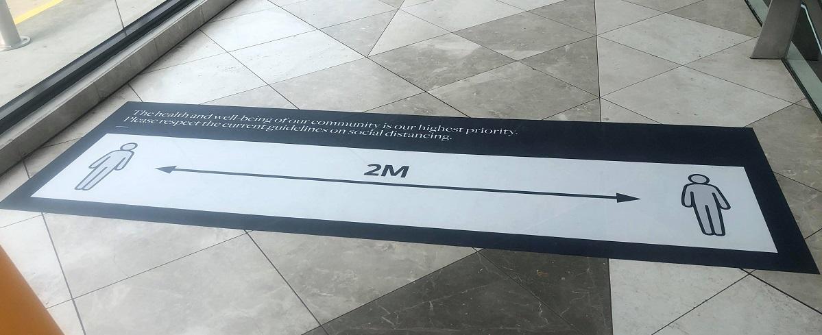 2 metre distance signs on floor at pacific werribee