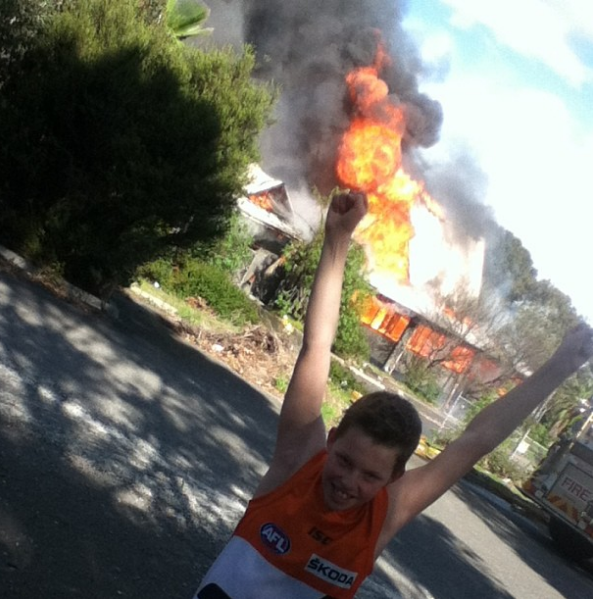 kid out the front of bundoora smorgys on fire
