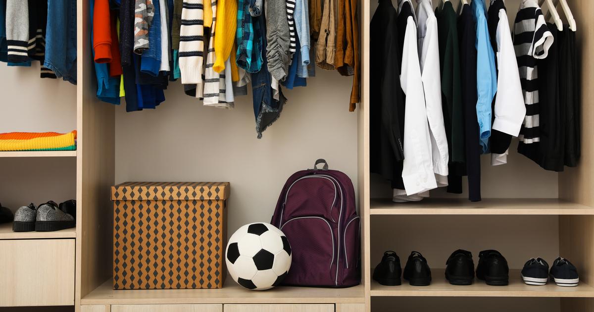 storage under hanging clothes